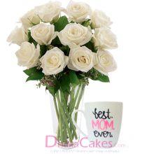 white roses in vase with mug to dhaka