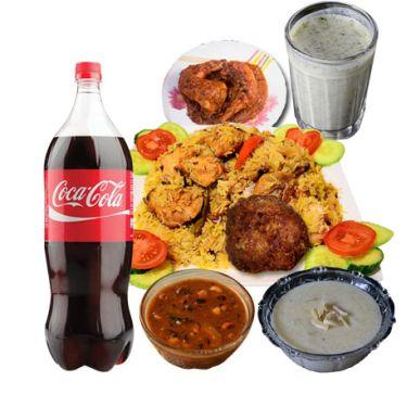 biryani with chicken roast,zali kabab,firney,chatni borhani and coke